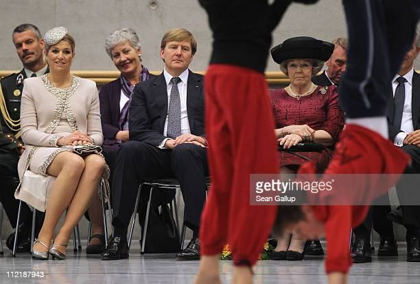 Princess Maxima Prince WillemAlexander and Queen Beatrix of the Netherlands watch children perform at the Palucca Dance High School on April 14 2011...
