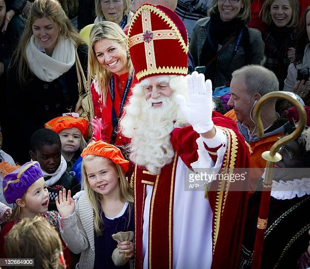Princess Maxima Princess Alexia Princess Ariane Princess Amalia and princess Alexiaof the Netherlands greet Sinterklaas and Zwarte Piet as the...