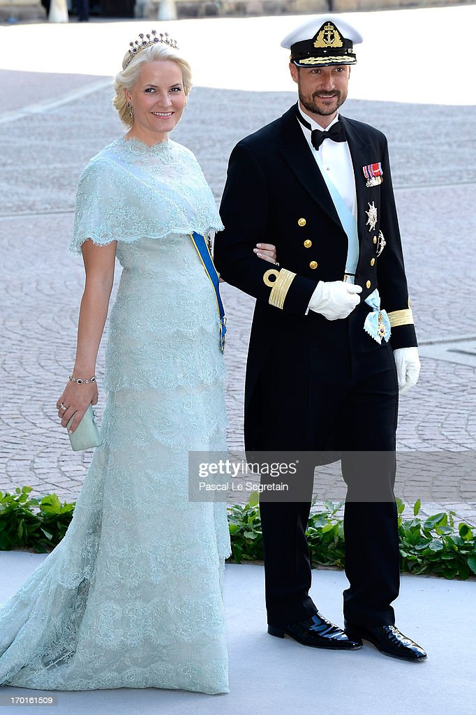 Princess Mette-Marit of Norway and <a gi-track='captionPersonalityLinkClicked' href=/galleries/search?phrase=Crown+Prince+Haakon+of+Norway&family=editorial&specificpeople=158362 ng-click='$event.stopPropagation()'>Crown Prince Haakon of Norway</a> attend the wedding of Princess Madeleine of Sweden and Christopher O'Neill hosted by King Carl Gustaf XIV and Queen Silvia at The Royal Palace on June 8, 2013 in Stockholm, Sweden.