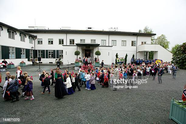 Princess MetteMarit of Norway and Prince Haakon of Norway greet the children on Norway's national day at Skaugum on May 17 2012 in Asker Norway