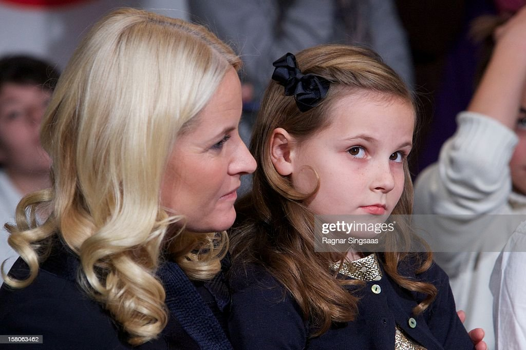 Princess Mette-Marit of Norway and <a gi-track='captionPersonalityLinkClicked' href=/galleries/search?phrase=Princess+Ingrid+Alexandra&family=editorial&specificpeople=243087 ng-click='$event.stopPropagation()'>Princess Ingrid Alexandra</a> of Norway attend the Save the Children's Peace Prize Festival at Nobel Peace Centre on December 10, 2012 in Oslo, Norway.