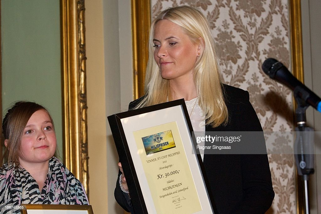 Princess Mette-Marit of Norway (R) presents the Co-Op environmental awards at National Theatre on April 16, 2013 in Oslo, Norway.