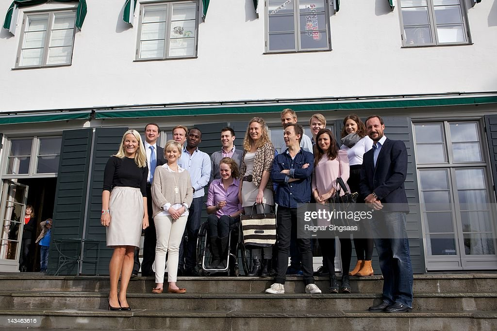 Princess Mette-Marit of Norway, Shafi Adan, Lisa Arntzen, Andreas Mjelde, Birgit Lovise Skarstein, Kristoffer Holm, Anne Louise Hubert, Sondre Lerche, Jonas Borchgrevink, Anders Mjaaset, Fatima Eikadi, Ingebjorg Hvidsten and Prince Haakon of Norway attend the opening of Global Shapers at Skaugum on April 27, 2012 in Asker, Norway.