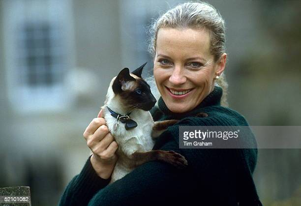 Princess Michael Of Kent Holding Her Pet Siamese Cat In The Gardens Of Her Home Nether Lypiatt Manor The Princess Is Wearing A Dark Green Wool...