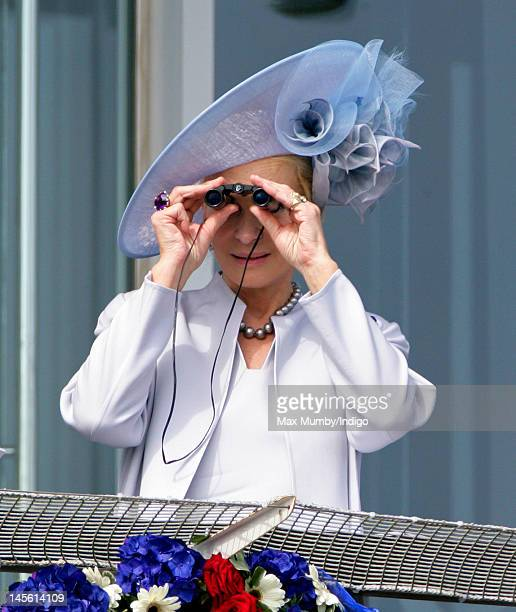Princess Michael of Kent watches the racing from the balcony of the Royal Box on Derby Day at the Investec Derby Festival horse racing meeting at...