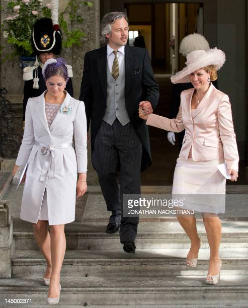 Princess of Sweden Madeleine Princess Martha Louise of Norway and her husband Ari Behn leave the Royal Chapel on May 22 2012 after the christening of...