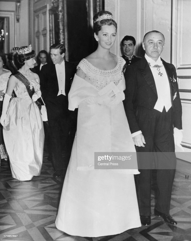 Princess Paola of Belgium (later Queen Paola of Belgium) followed by Princess Margaret Countess of Snowdon (1930 - 2002) and Antony Armstrong-Jones - 1st Earl of Snowdon, attend the pre-wedding celebrations for King Baudouin of Belgium and his bride Queen Fabiola of Belgium, Brussels, 14th December 1960 .