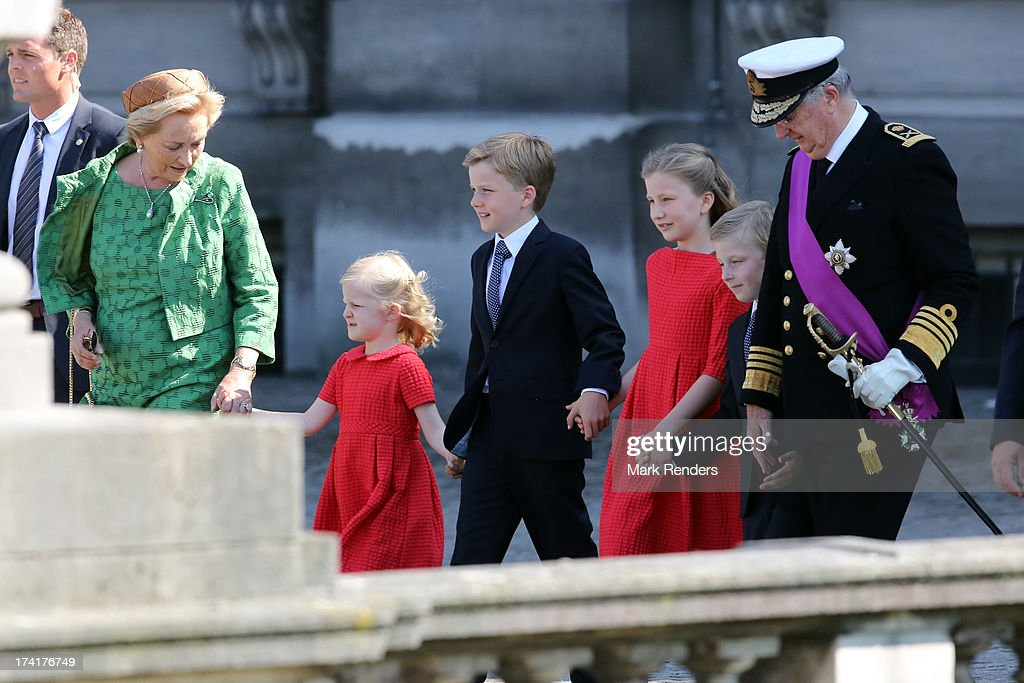 Princess Paola of Belgium, <a gi-track='captionPersonalityLinkClicked' href=/galleries/search?phrase=Princess+Eleonore+of+Belgium&family=editorial&specificpeople=5134592 ng-click='$event.stopPropagation()'>Princess Eleonore of Belgium</a>, <a gi-track='captionPersonalityLinkClicked' href=/galleries/search?phrase=Prince+Gabriel+of+Belgium&family=editorial&specificpeople=763403 ng-click='$event.stopPropagation()'>Prince Gabriel of Belgium</a>,<a gi-track='captionPersonalityLinkClicked' href=/galleries/search?phrase=Princess+Elisabeth+of+Belgium&family=editorial&specificpeople=763412 ng-click='$event.stopPropagation()'>Princess Elisabeth of Belgium</a>, <a gi-track='captionPersonalityLinkClicked' href=/galleries/search?phrase=Prince+Emmanuel+of+Belgium&family=editorial&specificpeople=763428 ng-click='$event.stopPropagation()'>Prince Emmanuel of Belgium</a> and King <a gi-track='captionPersonalityLinkClicked' href=/galleries/search?phrase=Albert+II+of+Belgium&family=editorial&specificpeople=159444 ng-click='$event.stopPropagation()'>Albert II of Belgium</a> attend the Civil and Military Parade during the Abdication Of King Albert II Of Belgium, & Inauguration Of King Philippe on July 21, 2013 in Brussels, Belgium.