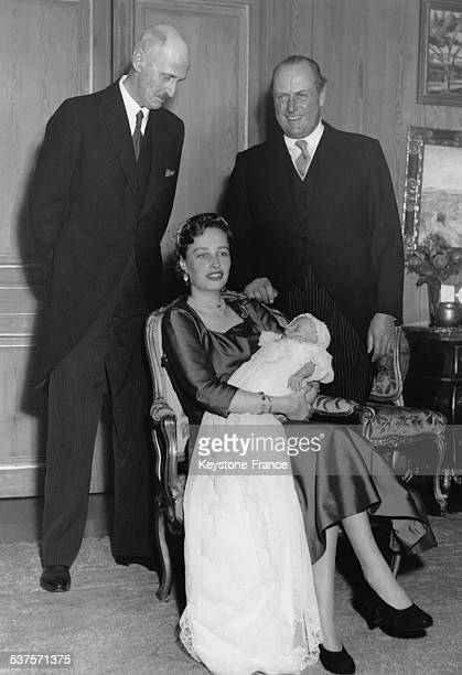 Princess Ragnhild holding his son Haakon in her arms surrounded by King Haakon VII and Prince Olav in 1954 in Oslo Norway