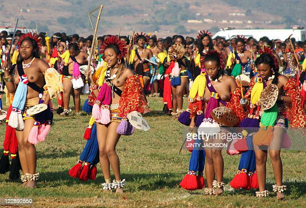 Princess Sikhanyiso Mswati's eldest daughter flanked by unmarried women from Swaziland dances for Africa's last absolute monarch King Mswati III at...
