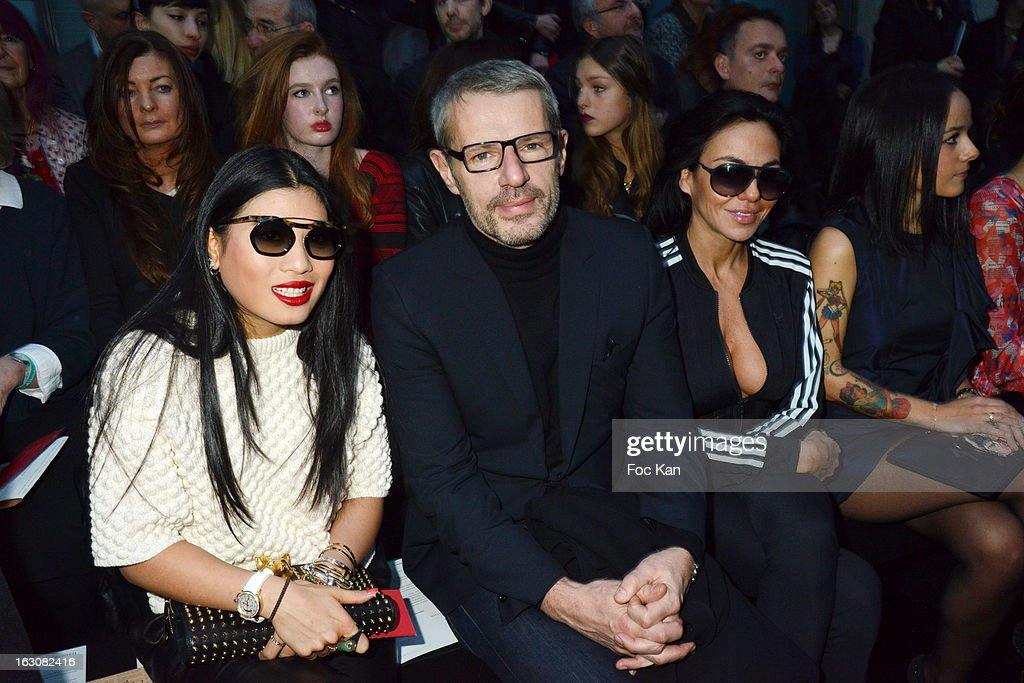 Princess Siriwanwaree of Tha•land, Lambert Wilson and Sandra Zeitoun attend the John Galliano - Front Row - PFW F/W 2013 at Le Centorial on March 3, 2013 in Paris, France.