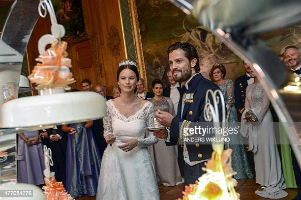 Princess Sofia and Prince Carl Philip eat cake during their wedding at the Royal Palace in Stockholm Sweden June 13 2015 AFP PHOTO / TT NEWS AGENCY /...