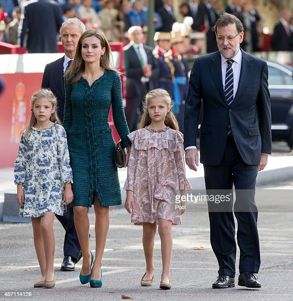 Princess Sofia of Spain Queen Letizia of Spain Princess Leonor of Spain and Spain's President Mariano Rajoy attend the Spanish National Day military...