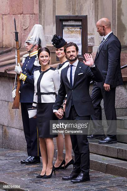 Princess Sofia Princess Madeleine and Prince Carl Phillip of Sweden depart after attending service at the Church of St Nicholas in connection with...