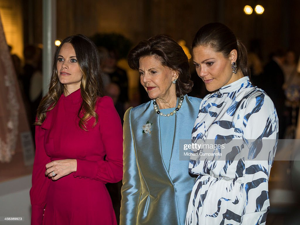 Princess Sofia, Queen Silvia, and Crown Princess Victoria of Sweden attend an exhibition of royal wedding dresses at the Royal Palace on October 17, 2016 in Stockholm, Sweden.