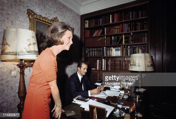 Princess Sophia of Spain standing next to her husband Juan Carlos seated at desk photographed together within the studying room of the Palace of the...