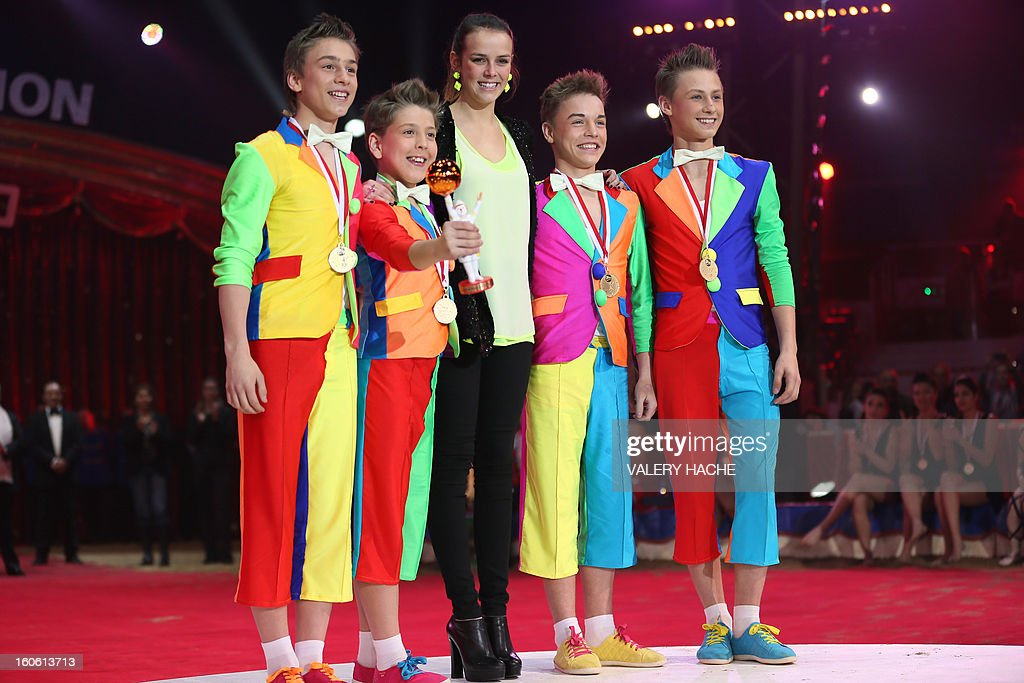 Princess Stephanie de Monaco's daughter Pauline Ducruet (C) poses with the Jugglers of de Kazan during the second New Generation International Circus Festival in Monaco on February 3, 2013. The event runs from February 2 until February 3, 2013.