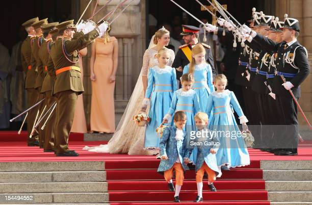 Princess Stephanie of Luxembourg and Prince Guillaume of Luxembourg leave the church after their wedding ceremony at the Cathedral of our Lady of...