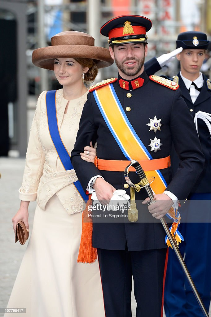 Princess Stephanie of Luxembourg and Prince Guillaume of Luxembourg depart the Nieuwe Kerk to return to the Royal Palace after the abdication of Queen Beatrix of the Netherlands and the Inauguration of King Willem Alexander of the Netherlands on April 30, 2013 in Amsterdam, Netherlands.