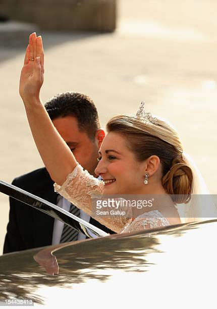 Princess Stephanie of Luxembourg is led to the church by her brother Count Jehan de Lannoy prior to the wedding ceremony of Prince Guillaume Of...