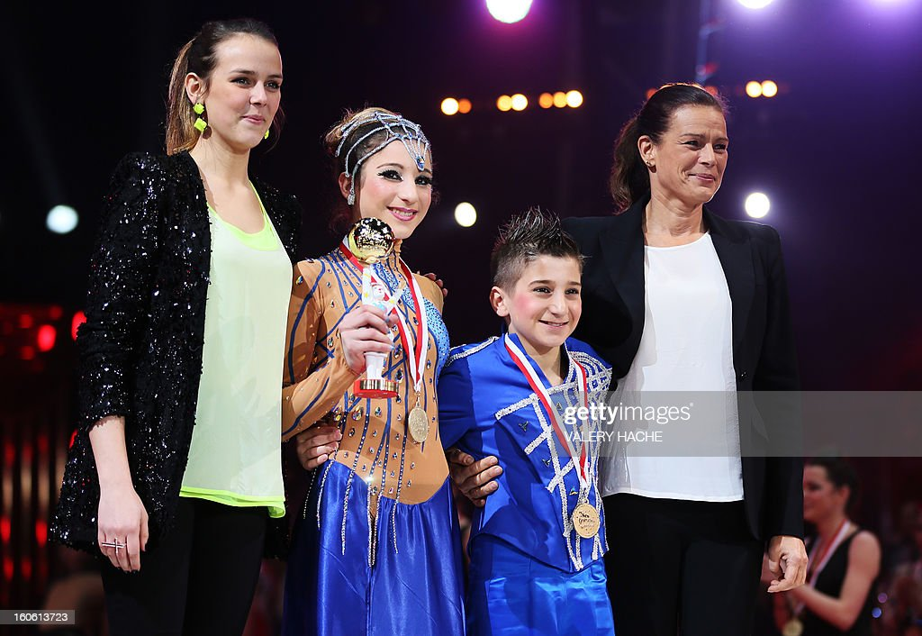 Princess Stephanie of Monaco (R) and her daughter Pauline Ducruet (L) pose with circus artists Maicol and Angela during the second New Generation International Circus Festival in Monaco on February 3, 2013. The event runs from February 2 until February 3, 2013.