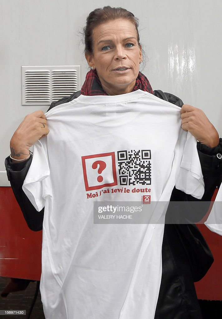 Princess Stephanie of Monaco (3rd l), President of Fight Aids Monaco (FAM) et UN Goodwill Ambassador poses with a t-shirt in Monaco on November 26, 2012 after an anonymous and free AIDS test for the forthcoming World AIDS Day . World AIDS Day, observed on 1 December every year, is dedicated to raising awareness of the AIDS pandemic caused by the spread of HIV infection. Translation is 'Me I lifted the doubt'AFP PHOTO / VALERY HACHE