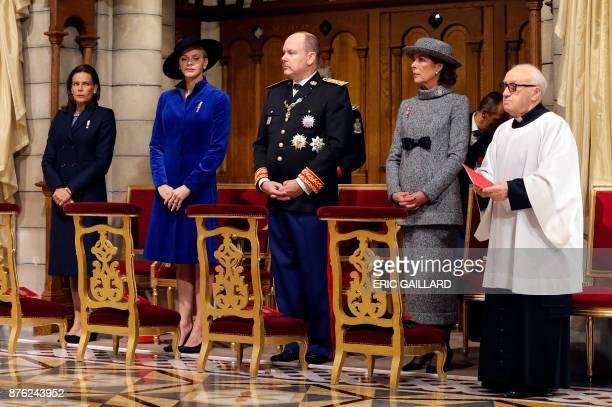 Princess Stephanie of Monaco Princess Charlene of Monaco Prince Albert II of Monaco and Princess Caroline of Hanover attend a mass at the Saint...