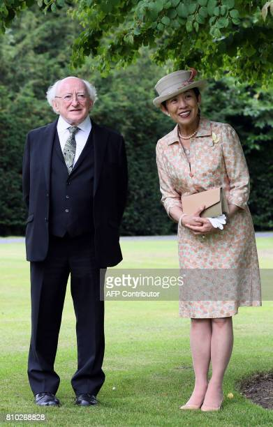 HIH Princess Takamado of Japan and Irish President Michael D Higgins walk through the gardens of his residence Aras an Uachtarain where she visited a...