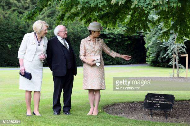 HIH Princess Takamado of Japan Irish President Michael D Higgins and his waife Sabina walk through the gardens of his residence Aras an Uachtarain...