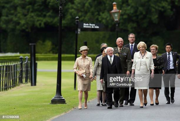 HIH Princess Takamado of Japan Irish President Michael D Higgins and his wife Sabina walk through the gardens of his residence Aras an Uachtarain...