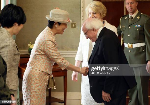 HIH Princess Takamado of Japan shakes hands with Irish President Michael D Higgins as his wife Sabina looks on at his residence Aras an Uachtarain in...