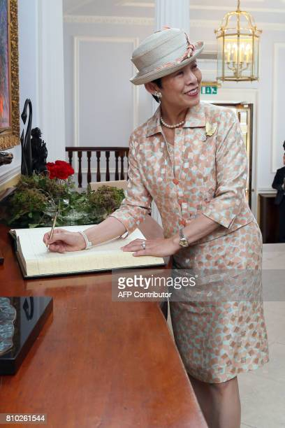 HIH Princess Takamado of Japan signs the visitors' book on her arrival at Aras an Uachtarain the residence of Irish President Michael D Higgins in...