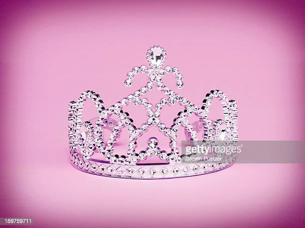 Princess tiara on pink background