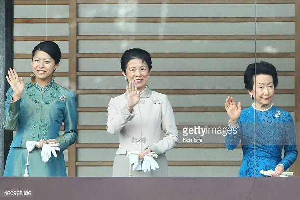 Princess Tsuguko Princess Hisako of Takamado and Princess Hanako of Hitachi wave to wellwishers during the celebration for the New Year on the...