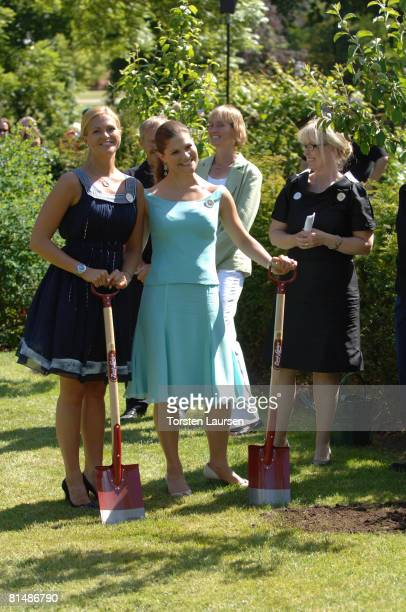 Princess Victoria and Princess Madeleine plant a tree as they attend The Sigvard Bernadotte Exhibition opening at Sofiero on June 7 2008 in...