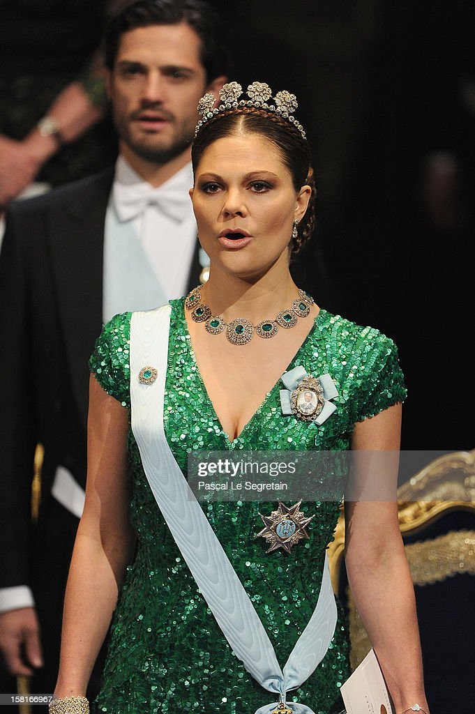 Princess Victoria of Sweden (R) and Prince Carl Philip of Sweden attend the 2012 Nobel Prize Award Ceremony at Concert Hall on December 10, 2012 in Stockholm, Sweden.