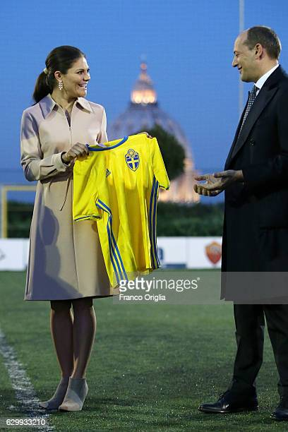 Princess Victoria of Sweden receives a Sweden national team football shirt from AS Roma General Manager Mauro Baldissoni as The Swedish Crown Couple...