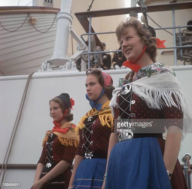 Princesses AnneMarie Benedikte and Margrethe of Denmark wearing traditional dress during a visit to Klaksvig in 1963