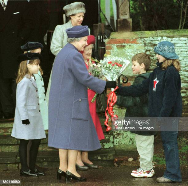 Princesses Beatrice and Eugenie and Princess Margaret watch the Queen Mother and the Queen receive presents from well wishers as they leave church on...