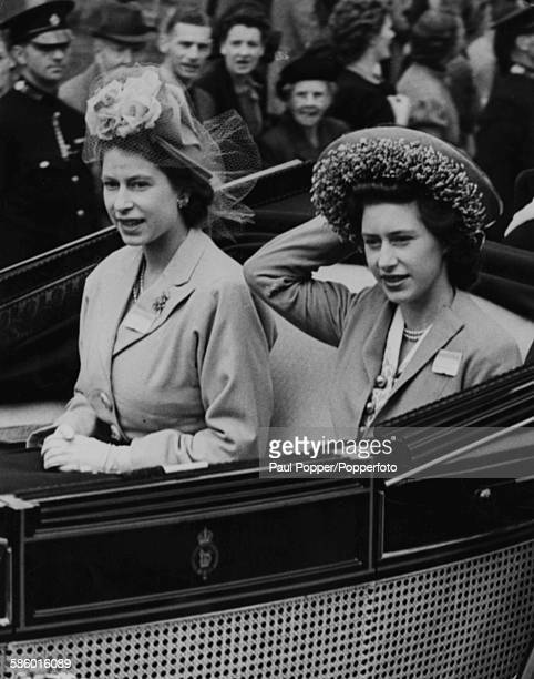 Princesses Elizabeth and Margaret drive in an open carriage at the Golden Gate in Ascot England to view the Royal Ascot race meeting on June 16th 1948
