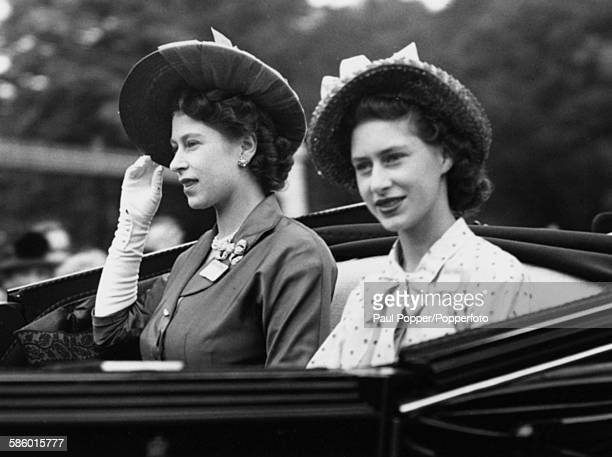Princesses Elizabeth and Margaret drive in an open carriage to the Royal box at Ascot Racecourse to watch the running of the Gold Cup race England...
