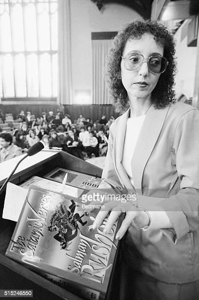 Princeton University professor poet essayist and National Book Award recipient Joyce Carol Oates holding Salman Rushdie's Satanic Verses during a...