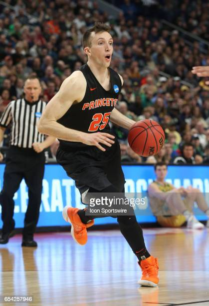 Princeton Tigers forward Steven Cook dribblesduring the NCAA Division I Men's Basketball Championship first round game between Princeton Tigers and...