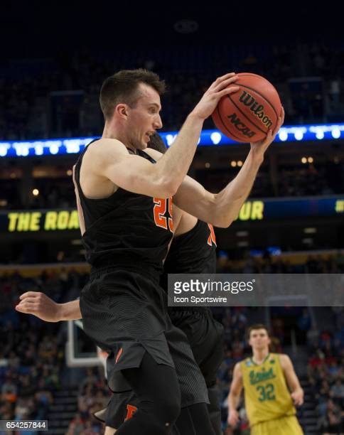 Princeton Tigers forward Steven Cook rebounds during the NCAA Division I Men's Basketball Championship first round game between Princeton Tigers and...
