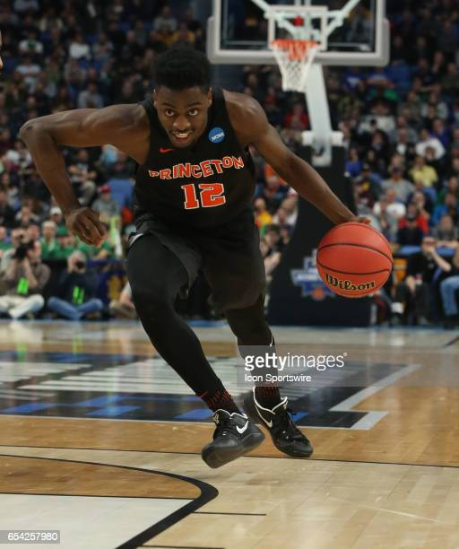 Princeton Tigers guard Myles Stephens dribbles during the NCAA Division I Men's Basketball Championship first round game between Princeton Tigers and...