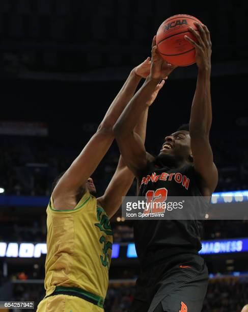 Princeton Tigers guard Myles Stephens is fouled by Notre Dame Fighting Irish forward Bonzie Colson during the NCAA Division I Men's Basketball...