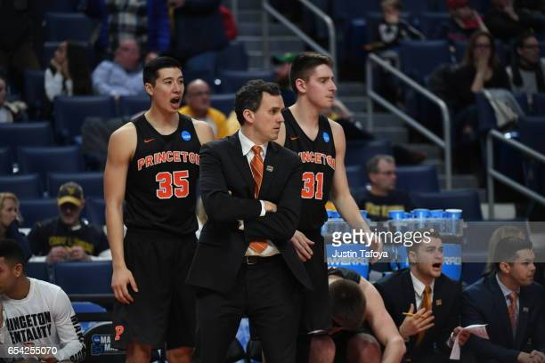 Princeton University Coach Mitch Henderson and players look on during the first round of the 2017 NCAA Men's Basketball Tournament held at KeyBank...