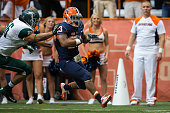 PrinceTyson Gulley of Syracuse Orange breaks past Greg Hillard of Wagner Seahawks for Syracuse's second touchdown on September 14 2013 at the Carrier...