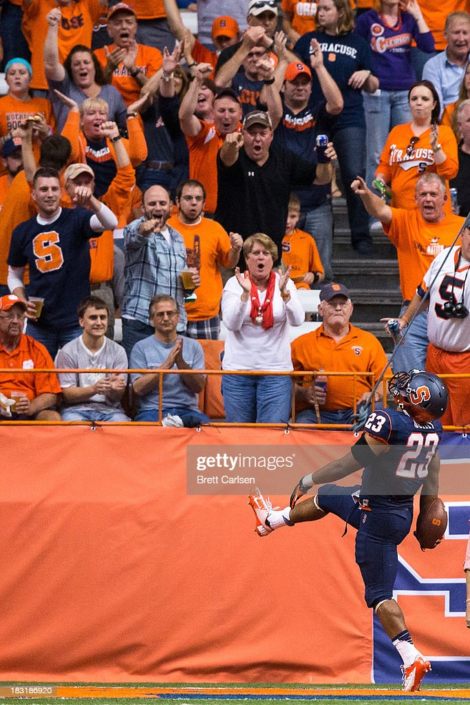 Prince-Tyson Gulley #23 of Syracuse Orange runs in a touchdown making the score Clemson 35- Syracuse 14 in the third quarter against Clemson Tigers on October 5, 2013 at the Carrier Dome in Syracuse, New York. Clemson defeated Syracuse 49-14.