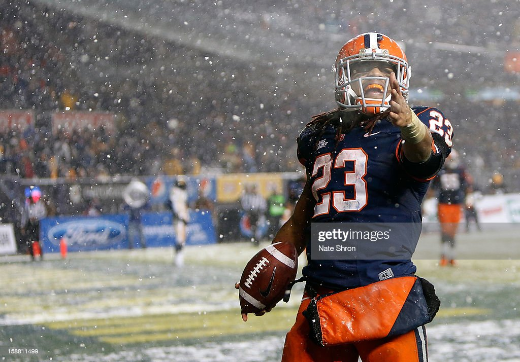 Prince-Tyson Gulley #23 of the Syracuse Orange celebrate after a touchdown against the West Virginia Mountaineers during the New Era Pinstripe Bowl at Yankee Stadium on December 29, 2012 in the Bronx borough of New York City.